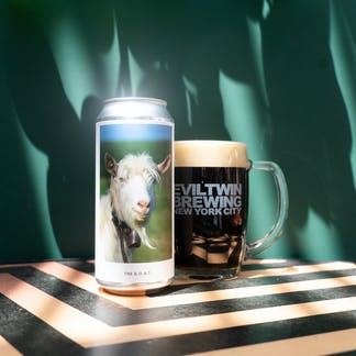 Picture of dopplebock beer with beer can and beer mug with Evil Twin logo