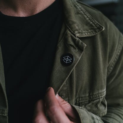 Black RB Logo Pin on shirt from a distance