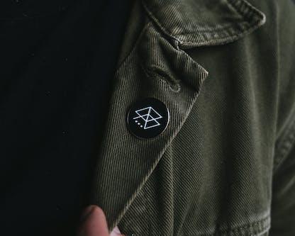 Black RB Logo Pin on shirt