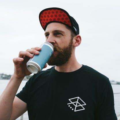 Run Club Member Drinking