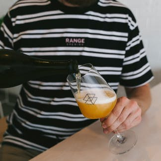 RB Striped Shirt with Beer in Foreground