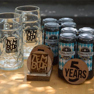 2 4 packs of temblorfest, anniversary coasters, 2 liter steins