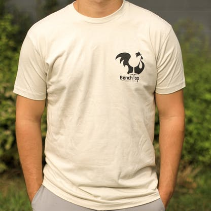 Tan shirt with Benchtop logo left chest