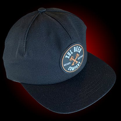 One panel black hat with a round rubber patch with our circle logo.