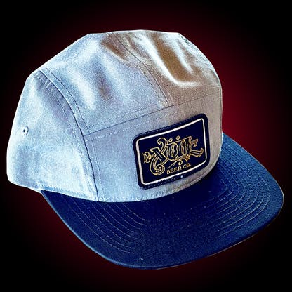 Five panel gray hat with our full logo in gold on a black woven patch