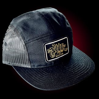 Five panel hat in black and black mesh with our full logo in gold on a black woven patch