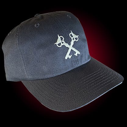 Charcoal dad hat with our crosskeys embroidered in silver