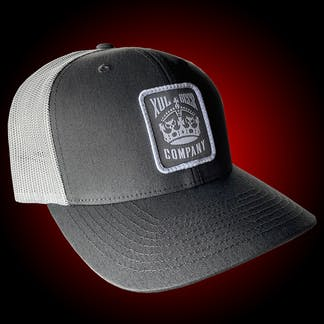 Gray trucker hat with our crown logo on a gray patch. Side view.