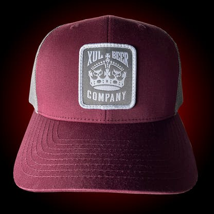 Maroon trucker hat with our crown logo on a gray patch. Front view