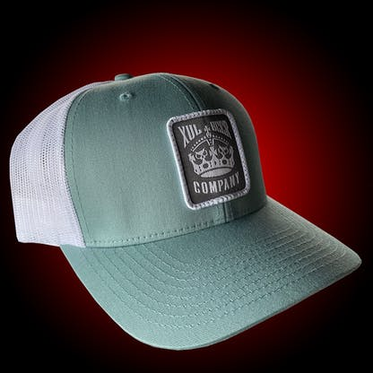 Seafoam trucker hat with our crown logo on a gray patch. Side view
