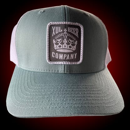 Seafoam trucker hat with our crown logo on a gray patch. Front view