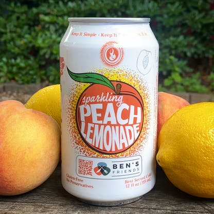 can of peach lemonade with fruit