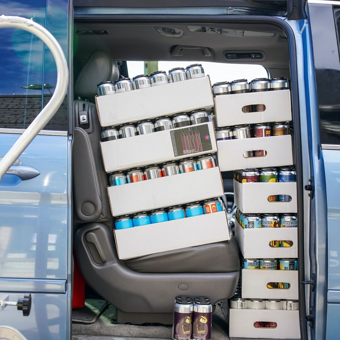 Cans in car for delivery